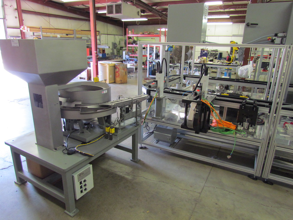 Vibratory bowl feeder on automated assembly line